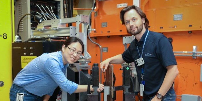 Researchers Michael Joachim Andreassen (right) from the Technical University of Denmark (DTU) and Zhenzhen Yu from the Colorado School of Mines use neutrons at the Department of Energy's (DOE's) Oak Ridge National Laboratory (ORNL) to investigate residual stresses expected to occur in the welds of offshore underwater wind turbine foundations. Credit: ORNL/Genevieve Martin
